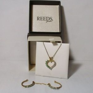 Reeds diamond emerald heart necklace and earrings